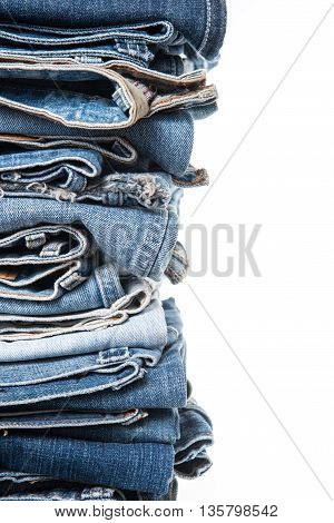 stack of jeans on white background .