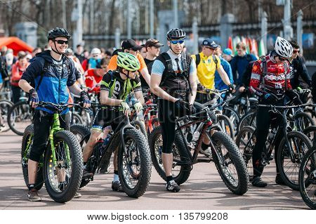Gomel, Belarus - April 10, 2015: Young men cyclists in sportswear for cycling on fat tires bikes at opening of the cycling season in city