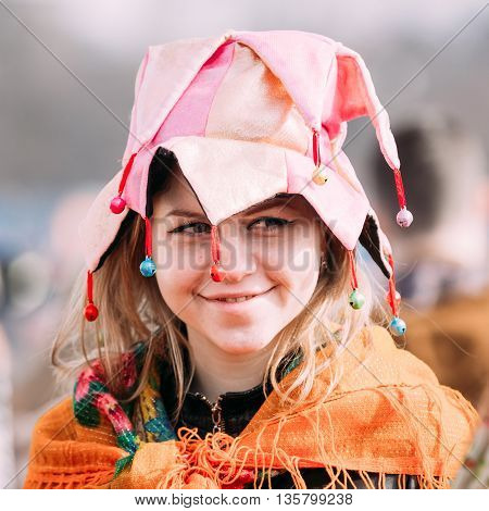 Gomel, Belarus - March 12, 2016: Portrait of unknown beautiful young woman girl in funny clothes at Celebration of Maslenitsa Shrovetide holiday.