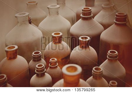 antique  bottles covered with dust in pharmaceutical laboratory