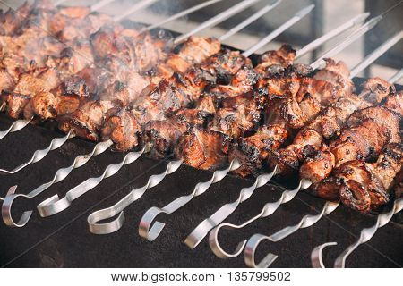 Grilled Marinated Caucasus Barbecue Meat Shashlik Shish Kebab Pork Meat Grilling On Metal Skewer. Nobody