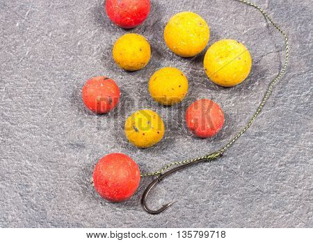 Carp Hook Boilies on black background. Close Up.
