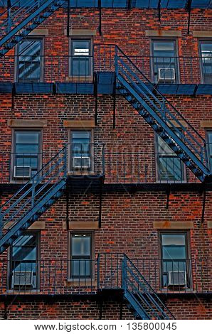 cityscape of a brick building and fire escapes