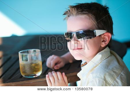 Stylish Little Boy Drinking Juice