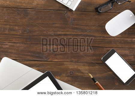 Tablet, Computer Notebook And Mobile Phone On Office Desk - Top View