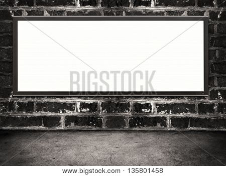 Blank screen hanging on grunge brick wall. information technology concept