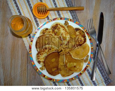 delicious pancakes with walnuts, raisins, honey , closeup