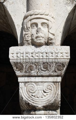 Head figure as the capital atop the column at the Fisherman's Bastion in Budapest Hungary
