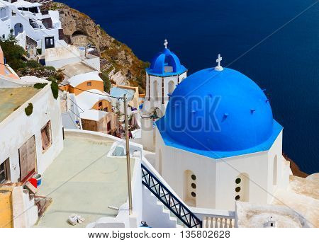 classical view of caldera with famous blue church domes, Oia, Santorini