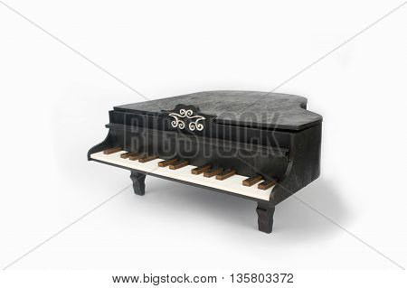 piano on white background. Toy piano black.