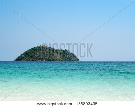 Beautiful Island in ocean sea with crystal green blue water sea and clear blue sky. Happy summer time concept.