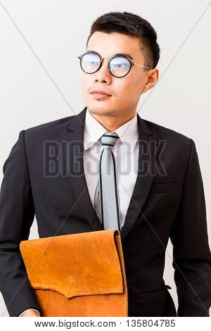Asian Smiling Young Business Man Glasses Carrying A Handmade Leather Bag