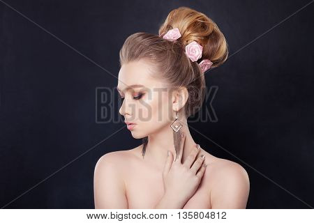 Blonde Woman on black background with Bridal Hairstyle