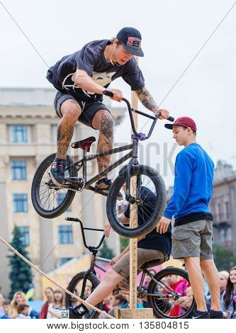 KHARKOV UKRAINE - JUNE 11 2016: Young guy is showing extreme jumps on a skate stage