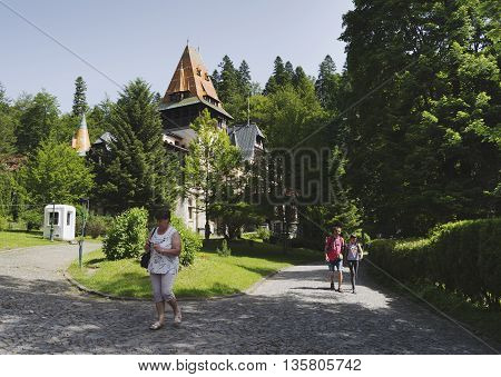 Sinaia, ROMANIA - June 18 2016: Tourists visiting Pelisor Castle, which is located next to the Peles castle in the Romanian city of Sinaia. SINAIA - June 18 2016