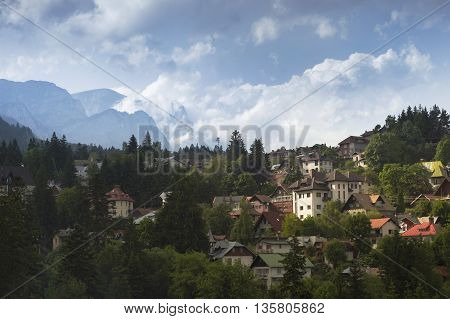 Sinaia, ROMANIA - June 18 2016: View of Bucegi mountains and houses in the city of Sinaia, Romania. SINAIA - June 18 2016