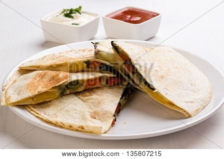 Quesadilla Slices On White Plate