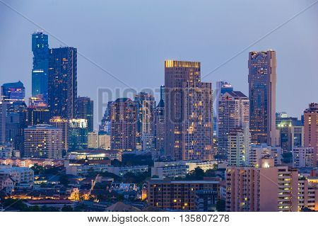 Central business office building tower with clear blue sky background at twilight