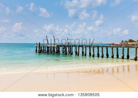 Wooden walking way on the beach leading to the sea natural landscape background