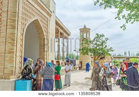 BUKHARA UZBEKISTAN - APRIL 29 2015: The numerous religious tourists visit the Bahauddin Nakshbandi complex on April 29 in Bukhara.