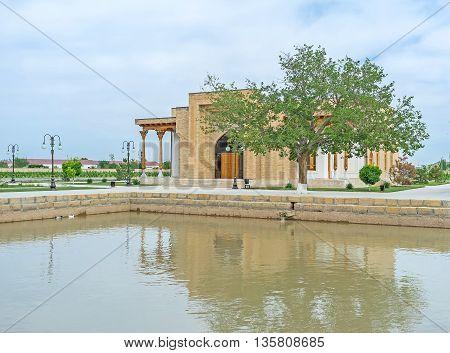 The restored modque behind the pool on the teritory of Bahauddin Nakshbandi complex Bukhara Uzbekistan.