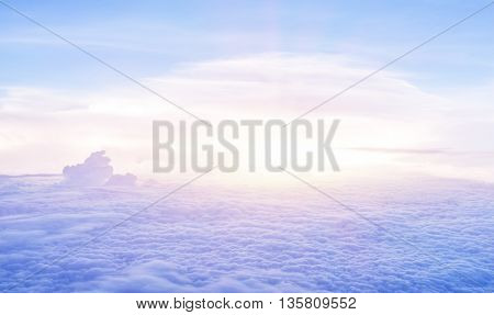 Beautiful heaven in the morning, flying over fluffy clouds, bright sun light, peaceful landscape, good weather, freedom concept