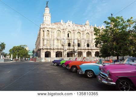 HAVANA, CUBA - JULY 05, 2015: American classic cabriolet cars parked before the Gran Teatro in Havana Cuba