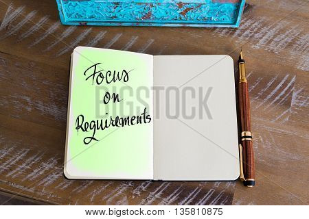 Handwritten Text Focus On Requirements over notebook, copy space available