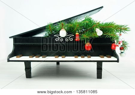 piano with christmas decorations on a white background