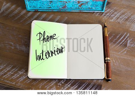 Handwritten Text Phone Interview over notebook, copy space available