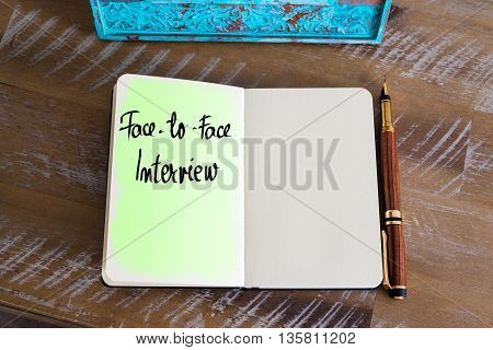 Handwritten Text Face-To-Face Interview over notebook, copy space available