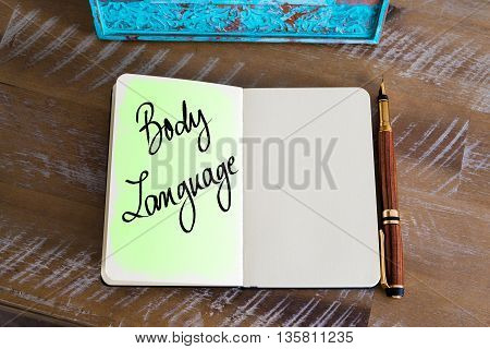 Handwritten Text Body Language over notebook, copy space available