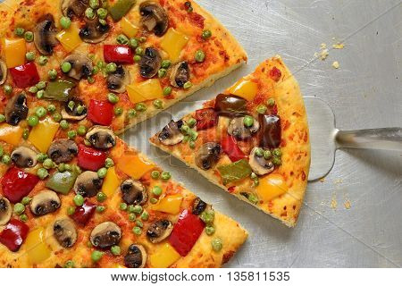 Vegetarian pizza with mushrooms paprika and green peas, top view