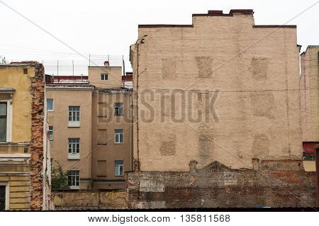 Traces of a ruined house on the wall of a neighboring house.