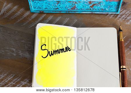 Text Summer handwritten over notebook, copy space available