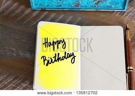 Greeting Happy Birthday over notebook, copy space available
