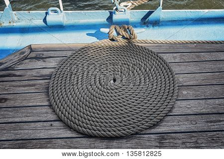 On the deck a neatly coiled rope ship