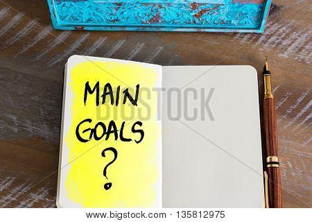 Question Main Goals ? Handwritten On Notebook