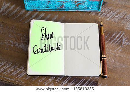 Text Show Gratitude handwritten over notebook, copy space available