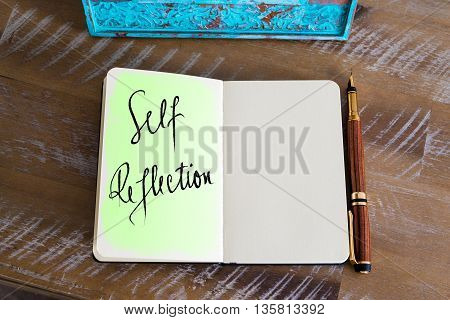 Handwritten Text Self Reflection over notebook, copy space available