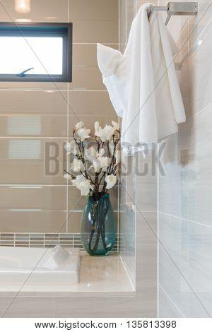 Clean White Towel On Hanger In Modern Bathroom