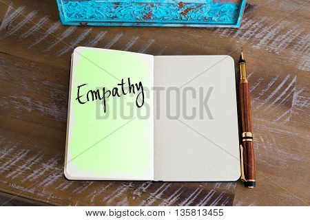 Handwritten Text Empathy over notebook, copy space available