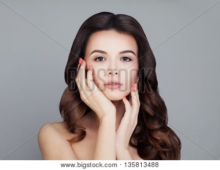 Healthy Hair Woman. Shiny Curly Hairstyle. Skin and Haircare Concept