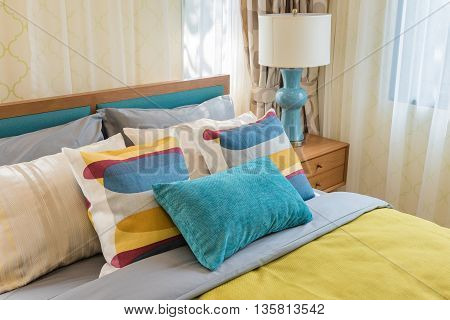 Colorful Pillows On Wooden Bed In Modern Bedroom Design