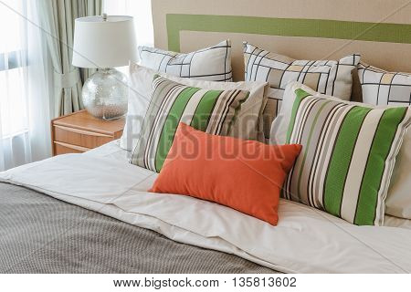 Colorful Pillows On White Bed In Modern Bedroom Design