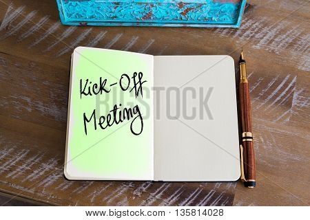 Handwritten Text Kick-Off Meeting over notebook, copy space available