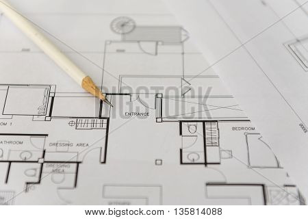 white pencil on architectural drawing for construction
