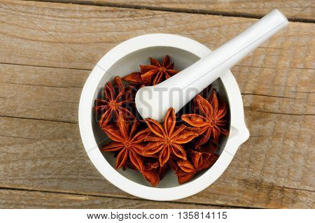 Star Anise in white mortar and pestle