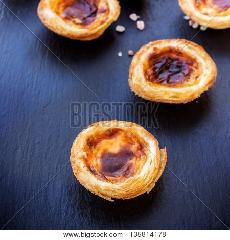 Egg tart on a grunge background, traditional portuguese dessert, pasteis de nata. Selective focus