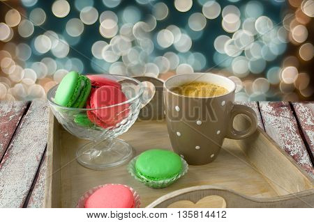 Colorful French Macarons with coffee. Christmas concept.